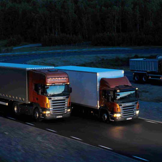 http://www.airswift.ae/wp-content/uploads/2015/09/Three-orange-Scania-trucks-540x540.jpg